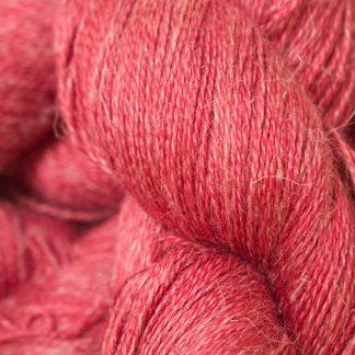 Semi-solid deep rose Baby Alpaca, silk and linen heavy laceweight yarn. Hand-dyed by Triskelion Yarn.