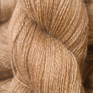 Light to mid brown Baby Alpaca, silk and linen heavy laceweight yarn. Hand-dyed by Triskelion Yarn.