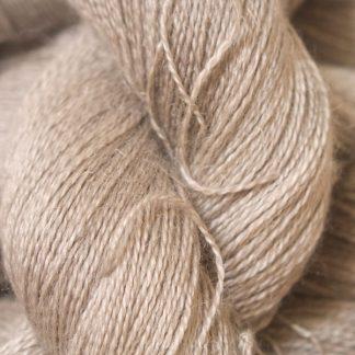 Light pebble grey Baby Alpaca, silk and linen heavy laceweight yarn. Hand-dyed by Triskelion Yarn.