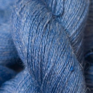 Semi-solid deep cornflower blue Baby Alpaca, silk and linen heavy laceweight yarn. Hand-dyed by Triskelion Yarn.