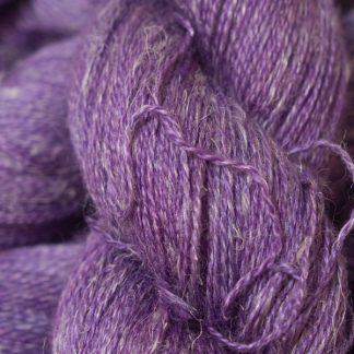 Semi-solid mid-tone purple Baby Alpaca, silk and linen heavy laceweight yarn. Hand-dyed by Triskelion Yarn.