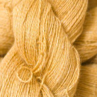 Sandy golden yellow Baby Alpaca, silk and linen heavy laceweight yarn. Hand-dyed by Triskelion Yarn.