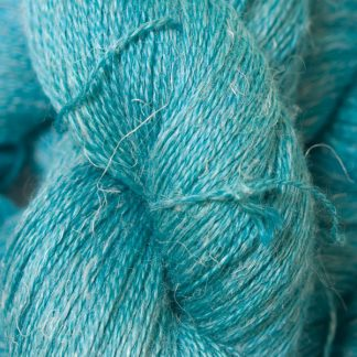 Mid-tone turquoise green Baby Alpaca, silk and linen heavy laceweight yarn. Hand-dyed by Triskelion Yarn.
