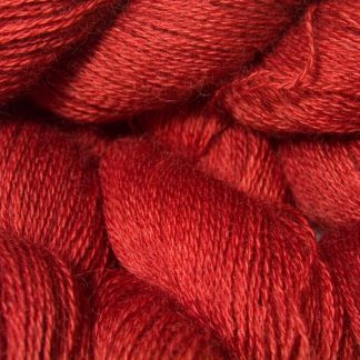 Mid-toned red hand-dyed Wensleydale DK/ Double Knit yarn. Hand-dyed by Triskelion Yarn