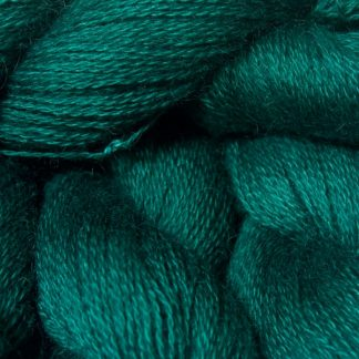 Mid to dark bluish-green hand-dyed Wensleydale DK/ Double Knit yarn. Hand-dyed by Triskelion Yarn