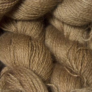 Reddish golden brown hand-dyed Wensleydale DK/ Double Knit yarn. Hand-dyed by Triskelion Yarn