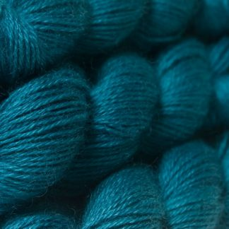 Semi-solid dark turquoise hand-dyed Wensleydale DK/ Double Knit yarn. Hand-dyed by Triskelion Yarn
