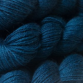 Semi-solid dark blue, with cobalt, sea blue and dark grey tones hand-dyed Wensleydale DK/ Double Knit yarn. Hand-dyed by Triskelion Yarn