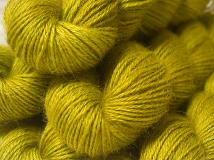 Semi-solid chartreuse green, with ochre and spring green tones hand-dyed Wensleydale DK/ Double Knit yarn. Hand-dyed by Triskelion Yarn