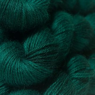 Semi-solid dark blue-green, with turquoise and grey tones hand-dyed Wensleydale DK/ Double Knit yarn. Hand-dyed by Triskelion Yarn