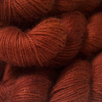 Semi-solid dark orange, with tones of copper, vermillion and russet hand-dyed Wensleydale DK/ Double Knit yarn. Hand-dyed by Triskelion Yarn