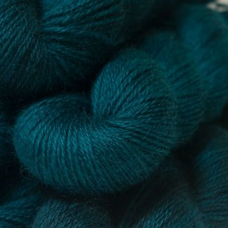 Semi-solid dark sea blue, with petrol blue, teal and sea green tones hand-dyed Wensleydale DK/ Double Knit yarn. Hand-dyed by Triskelion Yarn