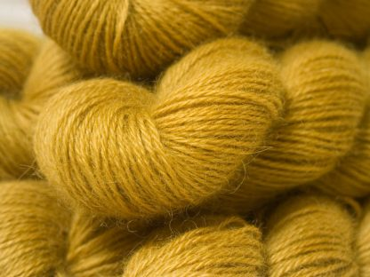 Semi-solid yellow, with tones of ochre and antique gold hand-dyed Wensleydale DK/ Double Knit yarn. Hand-dyed by Triskelion Yarn