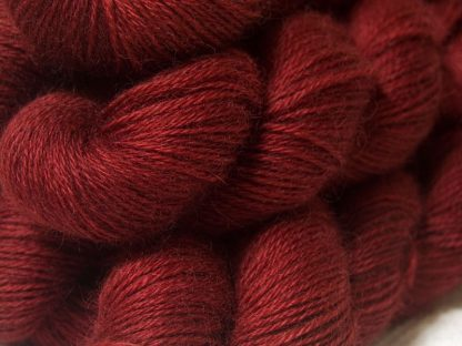 Semi-solid mid to dark red, with brick and scarlet tones hand-dyed Wensleydale DK/ Double Knit yarn. Hand-dyed by Triskelion Yarn