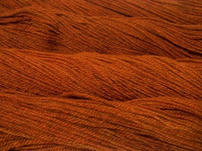 Semi-solid dark orange, with tones of copper, vermillion and russet Bluefaced Leicester (BFL) / Masham aran yarn. Hand-dyed by Triskelion Yarn