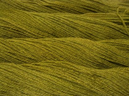 Semi-solid chartreuse green, with ochre and spring green tones Bluefaced Leicester (BFL) / Masham aran yarn. Hand-dyed by Triskelion Yarn