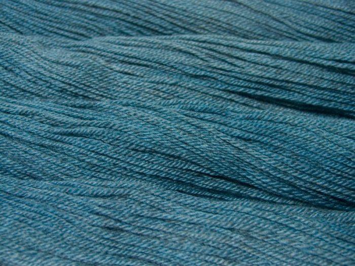 Semi-solid light sky blue, with powder blue and grey tones Bluefaced Leicester (BFL) / Masham aran yarn. Hand-dyed by Triskelion Yarn