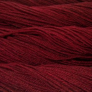 Semi-solid dark red, with tones of cherry and carmine Bluefaced Leicester (BFL) / Masham aran yarn. Hand-dyed by Triskelion Yarn