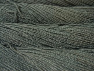 Semi-solid mid sea grey, with tones of aqua and sea green Bluefaced Leicester (BFL) / Masham aran yarn. Hand-dyed by Triskelion Yarn