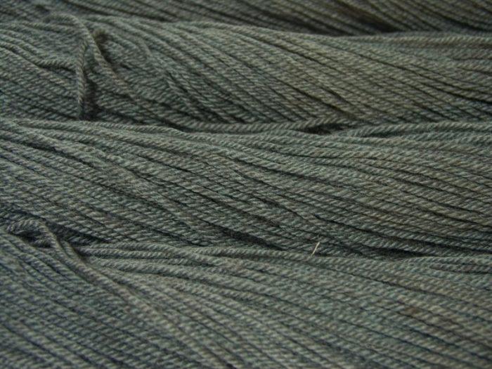 Semi-solid mid sea grey, with tones of aqua and sea green Bluefaced Leicester (BFL) / Masham aran yarn. Hand-dyed by Triskelion Yarn