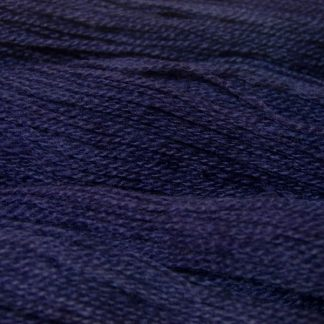 Semi-solid midnight blue, with violet and cobalt tones Bluefaced Leicester (BFL) / Gotland 4-ply (fingering) yarn. Hand-dyed by Triskelion Yarn