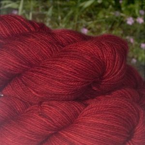 Alpacas of Wales semi solid intense welsh dragon red Suri & Baby Alpaca sport weight yarn. hand dyed by Triskelion Yarn