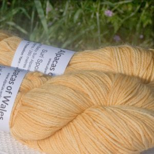 Alpacas of Wales semi-solid soft creamy yellow Suri & Baby Alpaca sport weight yarn. hand dyed by Triskelion Yarn