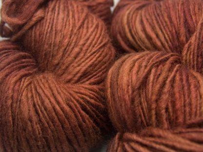 Epona - rich, dark chestnut brown Corriedale thick and thin slub yarn. Hand-dyed by Triskelion Yarn.
