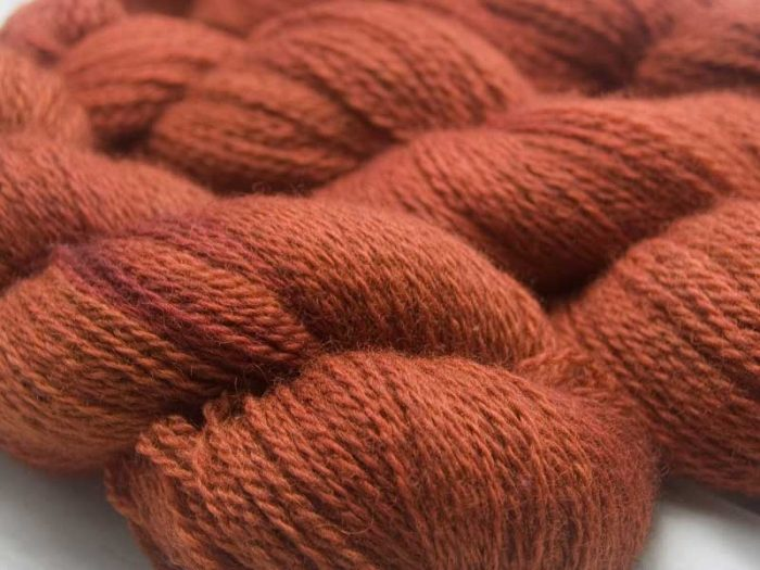 Burnt orange with dark tonal variations Bluefaced Leicester (BFL) / Masham aran yarn. Hand-dyed by Triskelion Yarn