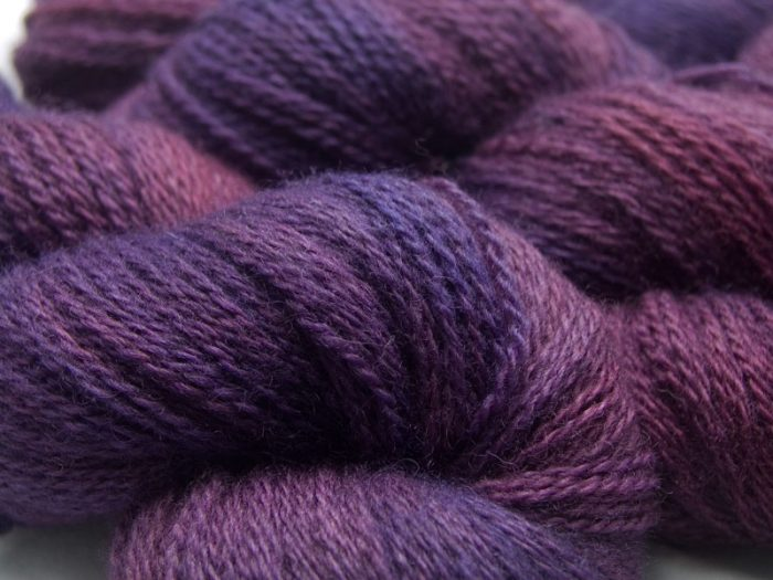 Mid-tone violet red with purple variations Bluefaced Leicester (BFL) / Masham aran yarn. Hand-dyed by Triskelion Yarn