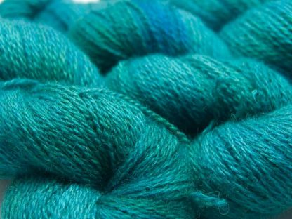 Mid-tone turquoise with blue-green variations Bluefaced Leicester (BFL) / Masham aran yarn. Hand-dyed by Triskelion Yarn
