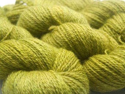 Semi-solid pear green Bluefaced Leicester (BFL) / Masham aran yarn. Hand-dyed by Triskelion Yarn