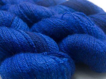 Semi-solid deep blue with dark tonal variations Bluefaced Leicester (BFL) / Masham aran yarn. Hand-dyed by Triskelion Yarn