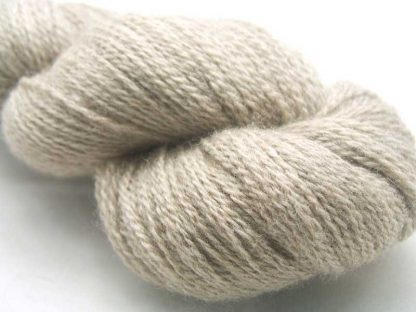 Oat - Semi-solid to solid soft cool beige Bluefaced Leicester (BFL) / Masham aran yarn. Hand-dyed by Triskelion Yarn
