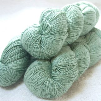Snowdrop - Pale silvery green Falklands Merino and silk blend yarn. Hand-dyed by Triskelion Yarn.