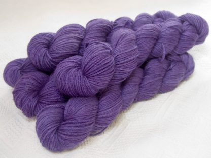 Saxnot - Semi-solid mid-tone purple Baby Alpaca Silk & Cashmere double-knit yarn. Hand-dyed by Triskelion Yarn.