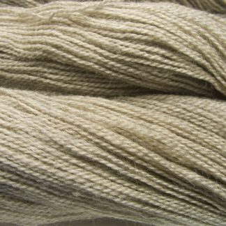 Pebble - Light pebble brownish grey Bluefaced Leicester (BFL) / Gotland 4-ply (fingering) yarn. Hand-dyed by Triskelion Yarn