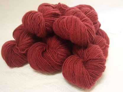 Berry - Mid-tone red Bluefaced Leicester (BFL) / Masham worsted yarn. Hand-dyed by Triskelion Yarn