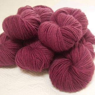 Cassiopeia - Rich mid-tone rose Bluefaced Leicester (BFL) / Masham worsted yarn. Hand-dyed by Triskelion Yarn
