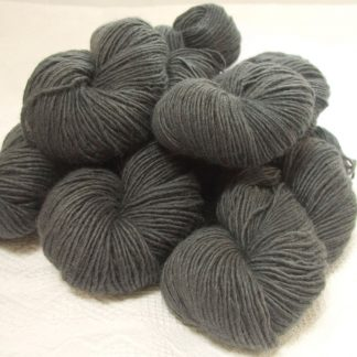 Graphite - Mid to dark grey Bluefaced Leicester (BFL) / Masham worsted yarn. Hand-dyed by Triskelion Yarn