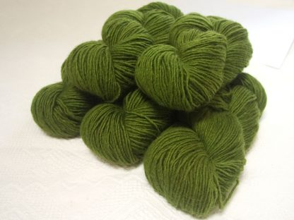 Rum and Laverbread - Semi-solid foliage green, with ochre and olive tones Bluefaced Leicester (BFL) / Masham worsted yarn. Hand-dyed by Triskelion Yarn