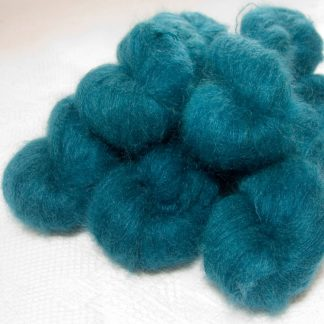 Captain Cat - Semi-solid dark turquoise kidsilk laceweight yarn. Hand-dyed by Triskelion Yarn