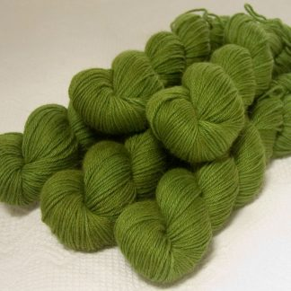 Rum and Laverbread - Semi-solid foliage green, with ochre and olive tones Baby Alpaca Silk & Cashmere double-knit yarn. Hand-dyed by Triskelion Yarn.