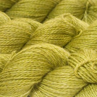 Frea - Semi-solid vibrant spring green Baby Alpaca, silk and linen sport weight yarn. Hand-dyed by Triskelion Yarn.