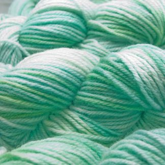 Pale ice blues and greens Shetland Aran yarn hand dyed by Triskelion Yarn