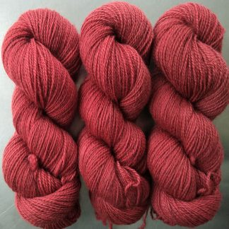 Semi-solid mid red, with brick and scarlet tones Bluefaced Leicester (BFL) / Gotland 4-ply (fingering) yarn. Hand-dyed by Triskelion Yarn