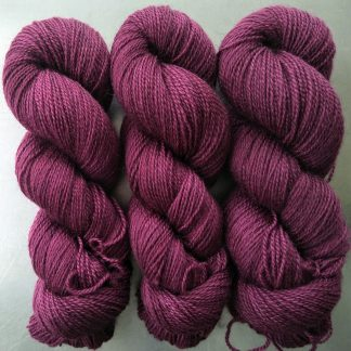 Damson - Mid-tone violet red Bluefaced Leicester (BFL) / Gotland 4-ply (fingering) yarn. Hand-dyed by Triskelion Yarn