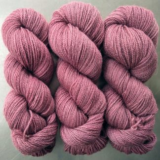 Eostre - Semi-solid dawn pink, with tones of scarlet and rose Bluefaced Leicester (BFL) / Gotland 4-ply (fingering) yarn. Hand-dyed by Triskelion Yarn