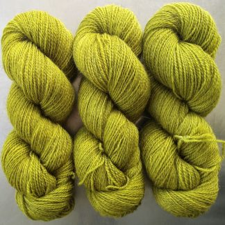Semi-solid chartreuse green, with ochre and spring green tones Bluefaced Leicester (BFL) / Gotland 4-ply (fingering) yarn. Hand-dyed by Triskelion Yarn