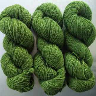 Semi-solid foliage green, with ochre and olive tones Bluefaced Leicester (BFL) / Gotland 4-ply (fingering) yarn. Hand-dyed by Triskelion Yarn